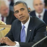US President Obama listens to Russian President Putin during the start of the G20 Working Session in St. Petersburg