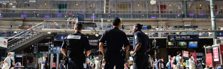 French police officers patrol at Gare du Nord train station in Paris, France, Saturday, Aug. 22, 2015. A gunman prepared to open fire with an automatic weapon on a high-speed train traveling from Amsterdam to Paris on Friday, wounding several people before being subdued by passengers, officials said. (AP Photo/Binta)