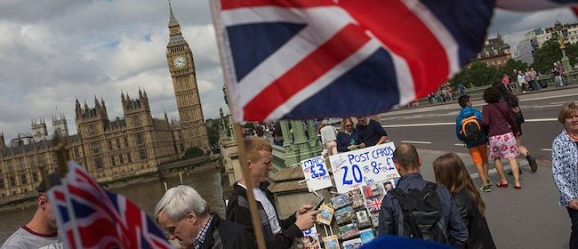 LONDON, ENGLAND - JUNE 25:  Tourists make their way over Westminster Bridge the day after the majority of the British public voted to leave the European Union on June 25, 2016 in London, England. The weakening of the pound against other currencies could mean good news for foreigners wishing to travel to the UK. The ramifications of the historic referendum yesterday that saw the United Kingdom vote to Leave the European Union are still being fully understood. The Labour leader, Jeremy Corbyn, who is under pressure from within his party to resign has blamed the 'Brexit' vote on 'powerlessness', 'austerity' and peoples fears over the issue of immigration.  (Photo by Dan Kitwood/Getty Images)