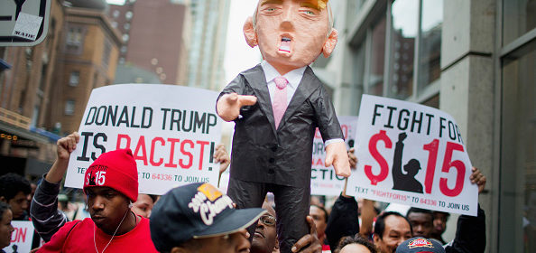 CHICAGO, IL - OCTOBER 12:  Demonstrators hold up a piñata of Republican Presidential candidate Donald Trump during a protest on October 12, 2015 in Chicago, Illinois. About 250 demonstrators marched through downtown before holding a rally calling for immigration reform and fair wages in front of Trump Tower. Trump has been an outspoken proponent of a plan to deport undocumented immigrants.  (Photo by Scott Olson/Getty Images)