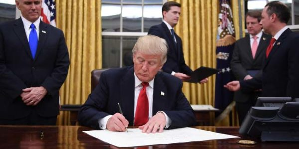 Trump signs executive order that could effectively gut Affordable Care Act's individual mandate