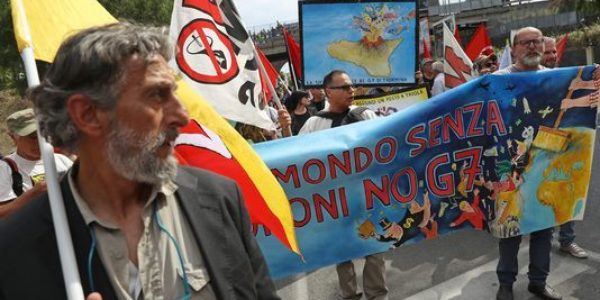 G-7 summit protesters rail against immigration, capitalism